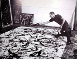 Jackson Pollock aan het schilderen.